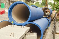 Corrugated water pipes of blue color, large diameter, prepared for laying. Plumbing or sewerage royalty free stock images