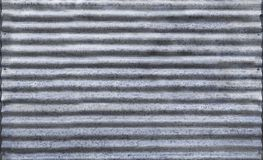 Corrugated zinc fence with old rusty surface silver for the background. stock image