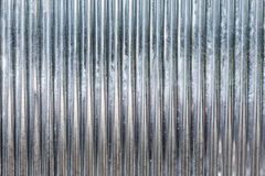 Corrugated zinc metal texture may be used as background Stock Image