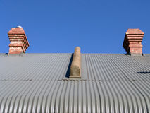 Corrugated zinc roof. A roof that looks like a face with eyes and a nose too Royalty Free Stock Photography