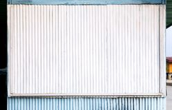 Corrugated zinc surface white and blue of the house is a roadside shop for the background and texture. With copy space for text. stock photos