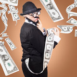 Corrupt business man money laundering US dollars Stock Photography