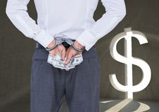 Corrupt businessman in handcuffs holding money against dollar sign Stock Image