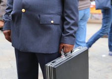 Corrupt cop with a suitcase full of money Stock Photo