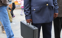 Corrupt cop with a suitcase full of money Stock Images