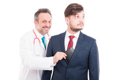 Corrupt medic taking businessman wallet. As fraud concept isolated on white background royalty free stock photography