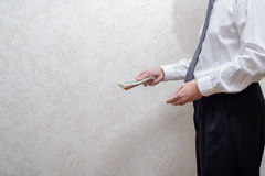 Corrupted businessman, or politician, paying a Dollars banknotes bribe Royalty Free Stock Image
