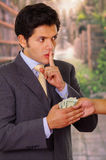 Corrupted young businessman accepting some money from a crook.  Royalty Free Stock Image