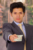 Corrupted young businessman with some money from a crook Royalty Free Stock Images