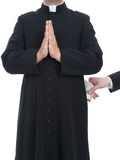 Corruptible priest Royalty Free Stock Photography