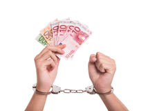 Corruption. Conceptual shot about corruption in Europe - male hands, handcuffs and Euro banknotes Stock Photo