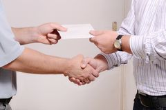 Corruption. Give someone money in envelop for corruption purposes Stock Image