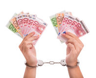 Corruption. Prisoner with handcuffs and money in his hands Royalty Free Stock Photography