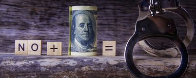 Corruption, bribe and law concept. `No` plus money is equal of handcuffs and prison stock photos