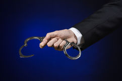 Corruption and bribery theme: businessman in a black suit with h Royalty Free Stock Photography