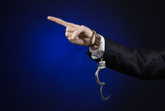 Corruption and bribery theme: businessman in a black suit with h Royalty Free Stock Photo