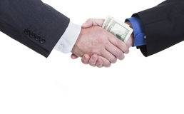 Corruption. A business handshake with money being exchanged on a white background with copy space Stock Photo