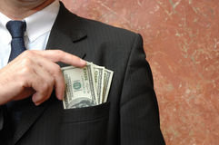 Corruption. Businessman with dollars bills in the pocket, concept of corruption Royalty Free Stock Photo