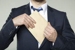 Corruption, businessman received an envelope with a bribe Royalty Free Stock Image