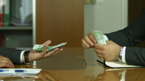 Corruption. Businessman in a suit takes a bribe stock video footage