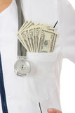 Corruption concept. Female doctor with money. Corruption concept Stock Photo