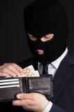 Corruption concept - man in business suit and mask holding leath Stock Photos