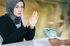 Corruption concept, young women try to bribe somebody. Image of corruption concept, young woman try to bribe somebody Royalty Free Stock Photo