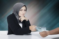 Corruption concept, young women try to bribe somebody. Image of corruption concept, young woman try to bribe somebody Stock Photography