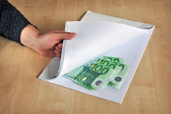 Corruption corrupting bribe. Concept of corruption, corrupting hand offering illegal eur money Royalty Free Stock Image
