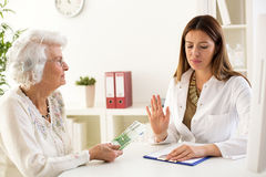 Corruption at medical office Stock Photography