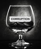 Corruption. Paper on glass in the dark Royalty Free Stock Photo