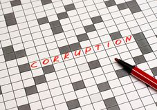 Corruption. Text in crossword. Red letters stock photo