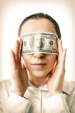 Corruption. Woman with a hundred dollars in her eyes Stock Image