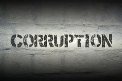 Corruption WORD GR. Corruption stencil print on the grunge white brick wall Royalty Free Stock Image