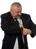 corruptness Mężczyzna kładzenia pieniądze w kostium kurtki kieszeni obrazy stock