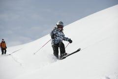Corsa con gli sci del bambino, alpi francesi Fotografia Stock
