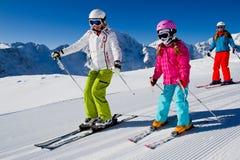 Corsa con gli sci, lezione del pattino Immagini Stock
