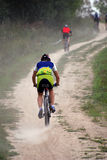 Corsa della bici di montagna Fotografia Stock