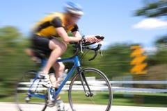 Corsa della bicicletta, sfuocatura di movimento immagini stock libere da diritti