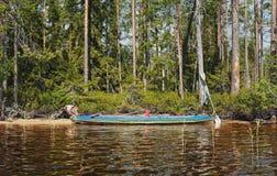 Corsa della canoa sul lago del nord Fotografie Stock