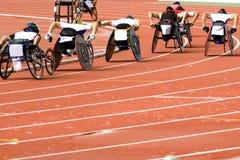 Corsa della presidenza di rotella per le persone invalide Fotografie Stock Libere da Diritti