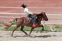 Corsa di cavalli tibetana Fotografie Stock