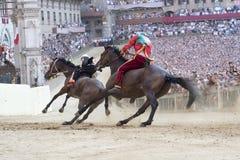 Corsa di cavallo di palio di Siena Immagini Stock