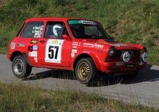 Corsa Vettura DA ein 112 Abarth SU passendes ruote Lizenzfreie Stockfotografie