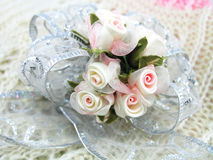 Corsage. Made from pretty little pink-and-white roses royalty free stock photography