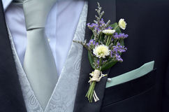 Corsage boutonniere brooch on groom suit Royalty Free Stock Image