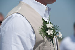 Corsage on a groom during a beach wedding Royalty Free Stock Photography