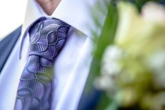 Corsage from man groom suit on wedding day. Stock Photos