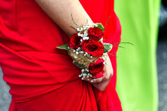 Corsage. A red rose corsage on a wrist Royalty Free Stock Photo