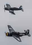 Corsair and Avenger in flight. A WW2 era Vought F4U Corsair and Grumman Avenger together in flight Royalty Free Stock Photography